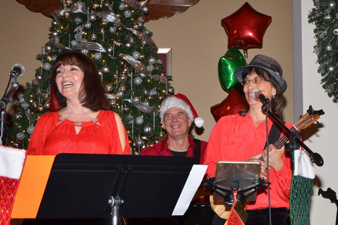 From left, Donna Roselli, Glenn Robinson and Doreen Poreba, members of the Connected Souls Band, are all smiles during their inaugural Intimate Christmas Coffee House.