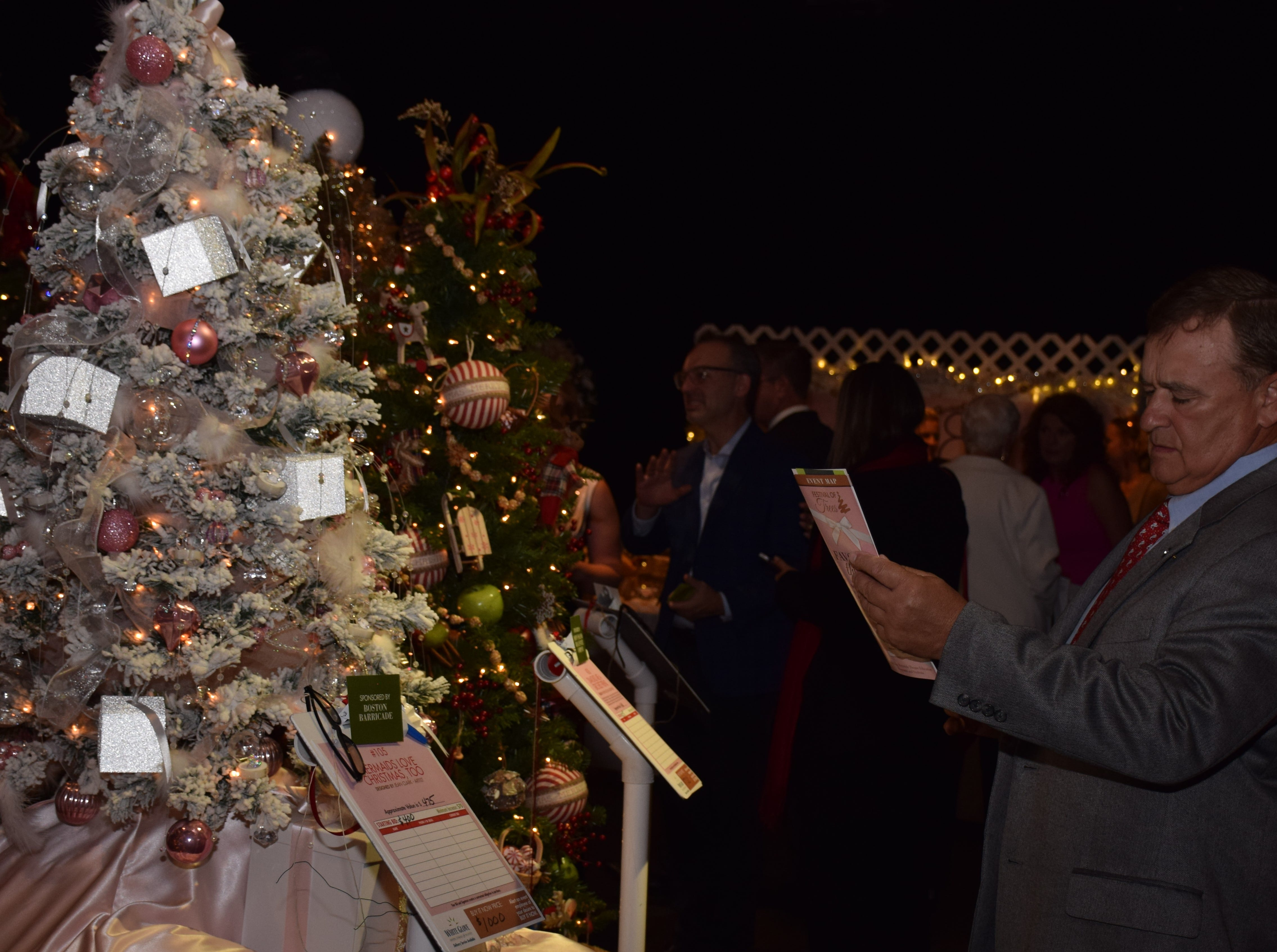 Attendees enjoyed the silent auction at the Festival of Trees.