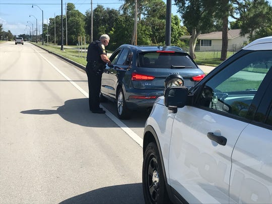 Port St. Lucie Police Sgt. Robert McGhee issues a warning to a motorist for speeding on Nov. 13, 2018.