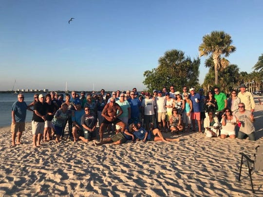 Freedom Boat Club of Fort Pierce members pose for a photo at one of their Island Socials.