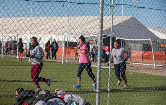 In this Nov. 25, 2018, photo, migrant teens held inside the Tornillo detention camp run at the facility. The Trump administration announced in June that it would open the temporary shelter for up to 360 migrant children in this isolated corner of the Texas desert. Less than six months later, the facility has expanded into a detention camp holding thousands of teenagers, and it shows every sign of becoming more permanent.