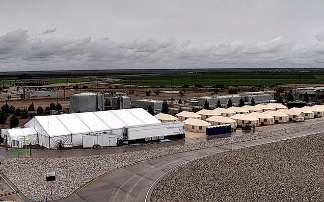 This undated file photo provided by the Administration for Children and Families, a division of the Department of Health and Human Services, shows the shelter used to house unaccompanied migrant children in Tornillo. The Trump administration announced in June that it would open the temporary shelter for up to 360 migrant children in this isolated corner of the Texas desert. Less than six months later, the facility has expanded into a detention camp holding thousands of teenagers, and it shows every sign of becoming more permanent.