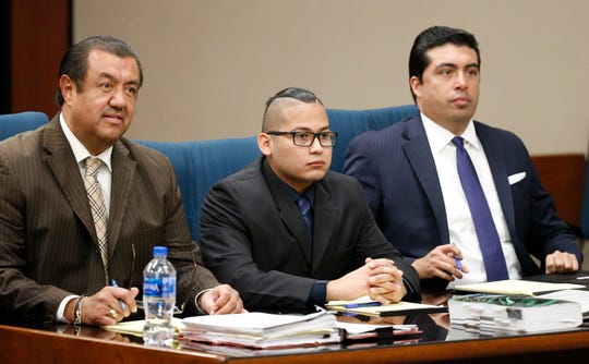 Reniery Adalberto Galeano, center, sits with his attorneys Sergio Saldivar, left, and Leonardo E. Maldonado on Thursday afternoon. Galeano faces one count of aggravated assault with a deadly weapon in connection with the stabbing of Blanca Rodriguez at about 3 a.m. Sept. 18, 2016, during a party at a house in the 200 block of Gus Rallis Drive. The trial is being held in the 168th District Court with Judge Marcos Lizarraga presiding and is expected to continue Friday.