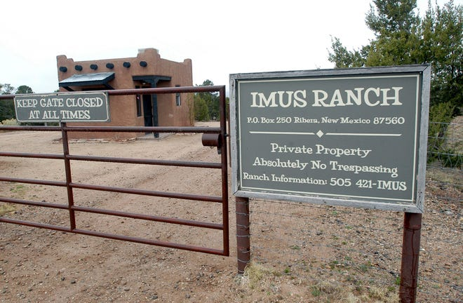 This April 12, 2007, file photo, shows the entrance to the Imus Ranch, once owned by radio personality Don Imus, in Ribera, New Mexico. The sprawling ranch in northern New Mexico was sold in 2018 to media mogul Patrick Gottsch, whose Rural Media Group plans to use it as a production base for its programming.