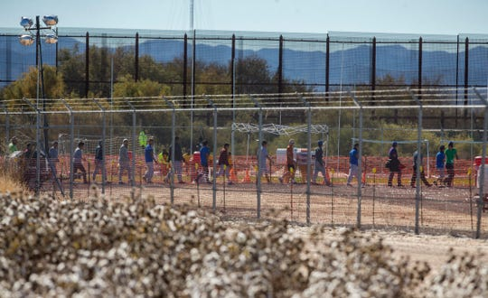 In this Nov. 15, 2018, photo, migrant teens are led in a line inside the Tornillo detention camp holding more than 2,300 migrant teens. The Trump administration announced in June that it would open the temporary shelter for up to 360 migrant children in this isolated corner of the Texas desert. Less than six months later, the facility has expanded into a detention camp holding thousands of teenagers, and it shows every sign of becoming more permanent.