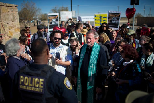 In this Nov. 15, 2018, photo, rabbis and other faith leaders talk with a Department of Homeland Security official outside the Tornillo detention camp holding more than 2,300 migrant teens in Tornillo. The Trump administration announced in June that it would open the temporary shelter for up to 360 migrant children in this isolated corner of the Texas desert. Less than six months later, the facility has expanded into a detention camp holding thousands of teenagers, and it shows every sign of becoming more permanent.