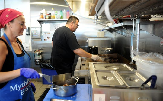 Nesrin Ulubay (left)  prepares food with Jimmy Biskin, owner of MythPoint Bistro in Thousand Oaks.