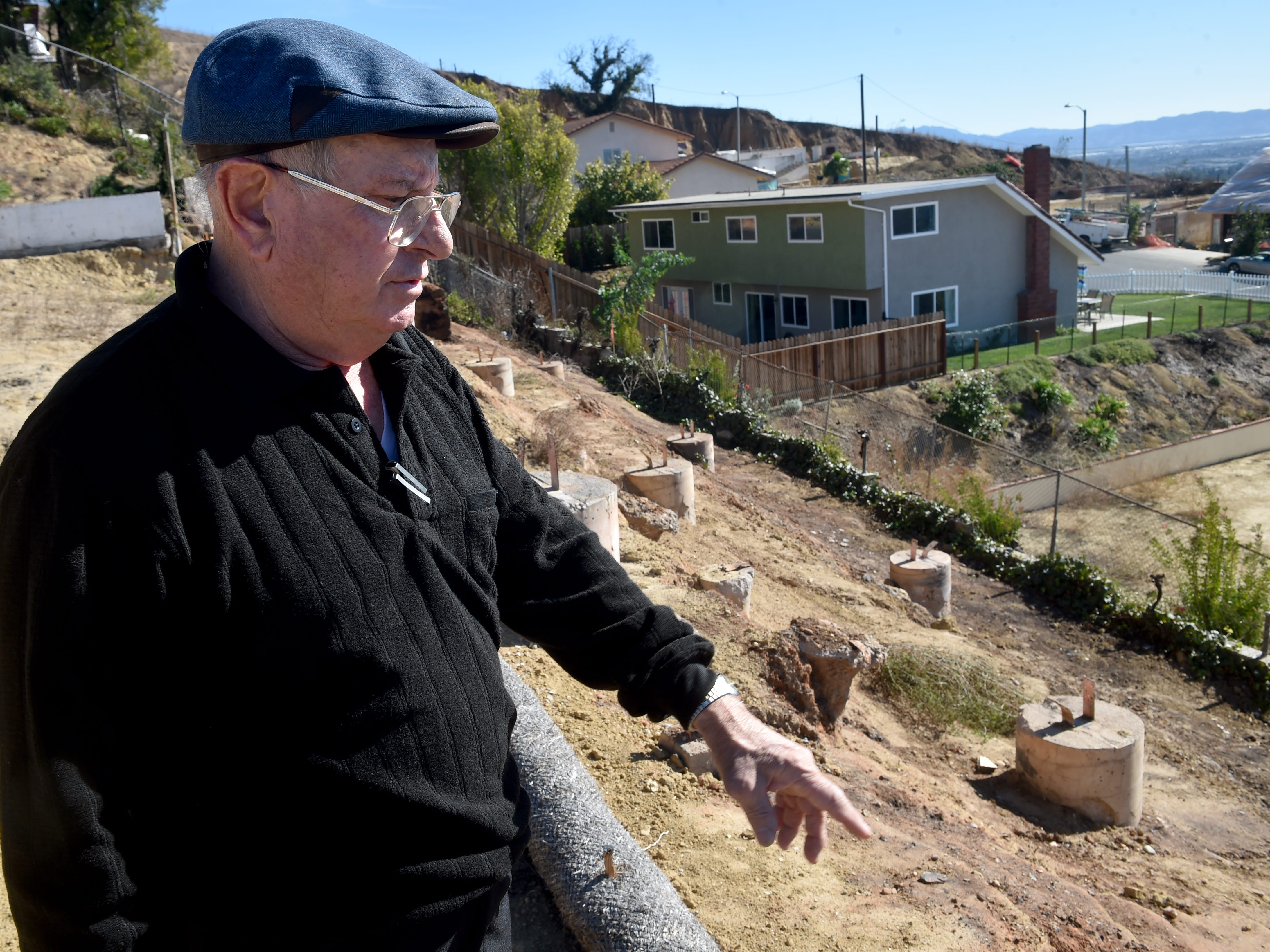 Carl Zaid, of Ventura, visits the lot on Crestone Court where his family's home burned in the Thomas Fire. Despite a shortage of contractors and other obstacles, Zaid and his family plan to rebuild.