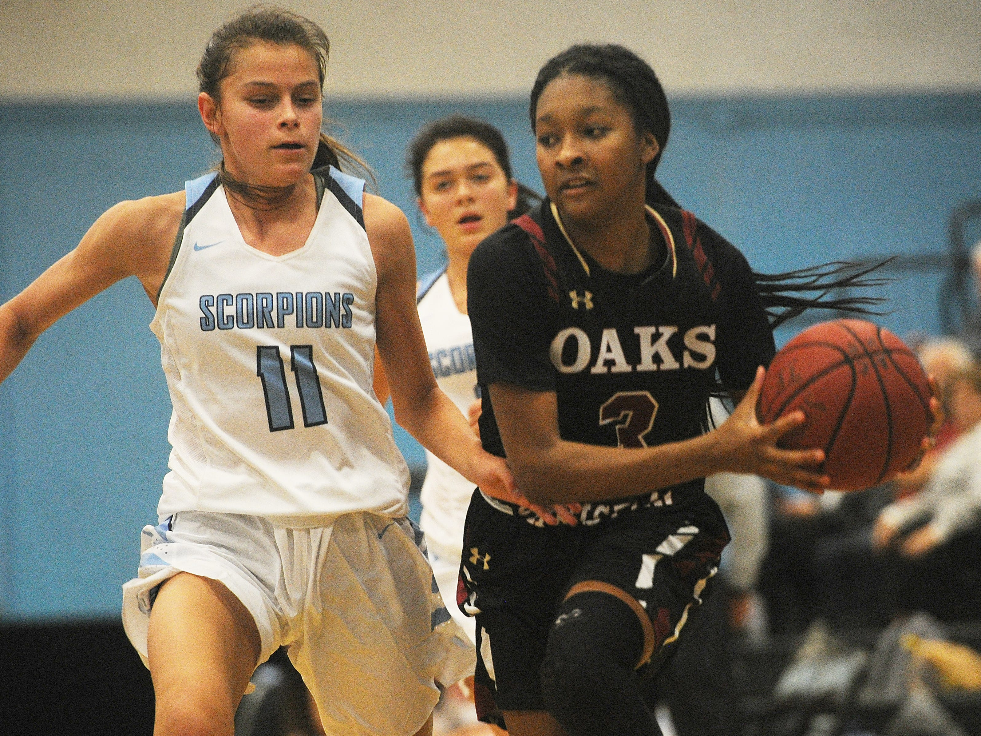 Oaks Christian Taylor Donaldson, right, is defended by Camarillo's Gabriela Jaquez, left, during the first game of 42nd annual Buena-Kiwanis Girls Basketball Tournament at Buena High on Wednesday. Camarillo won, 62-37.