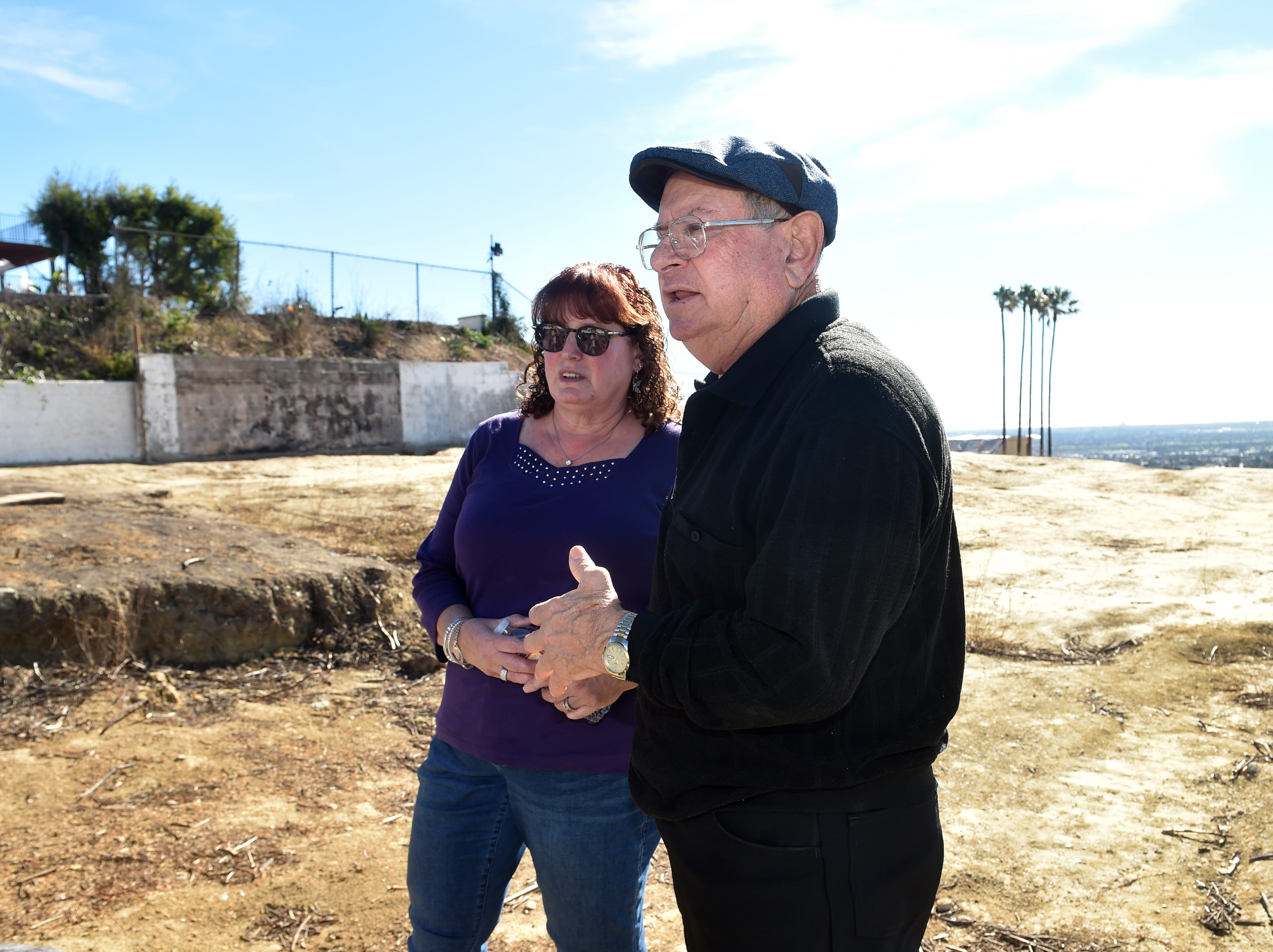 Carl Zaid and his wife, Lisa, of Ventura, visit the lot on Crestone Court where their home burned in the Thomas Fire. Despite issues with contractors and other obstacles, the Zaids plan to rebuild.