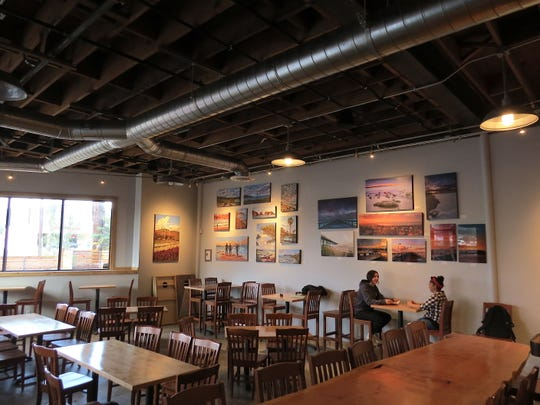 Works by local artists are seen in the dining area at Rincon Brewery in Ventura, slated to open by mid-December.