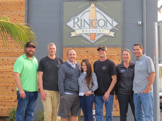 It takes a village: Posing in front of the opening-soon Ventura location of Rincon Brewery are, from left, chef Steven Stroh, head brewer Chas Cloud, general manager Jason Steffenauer and co-owners Alma Billgren, Kevin Clark, Luisa Hyatt and Mark Hyatt.