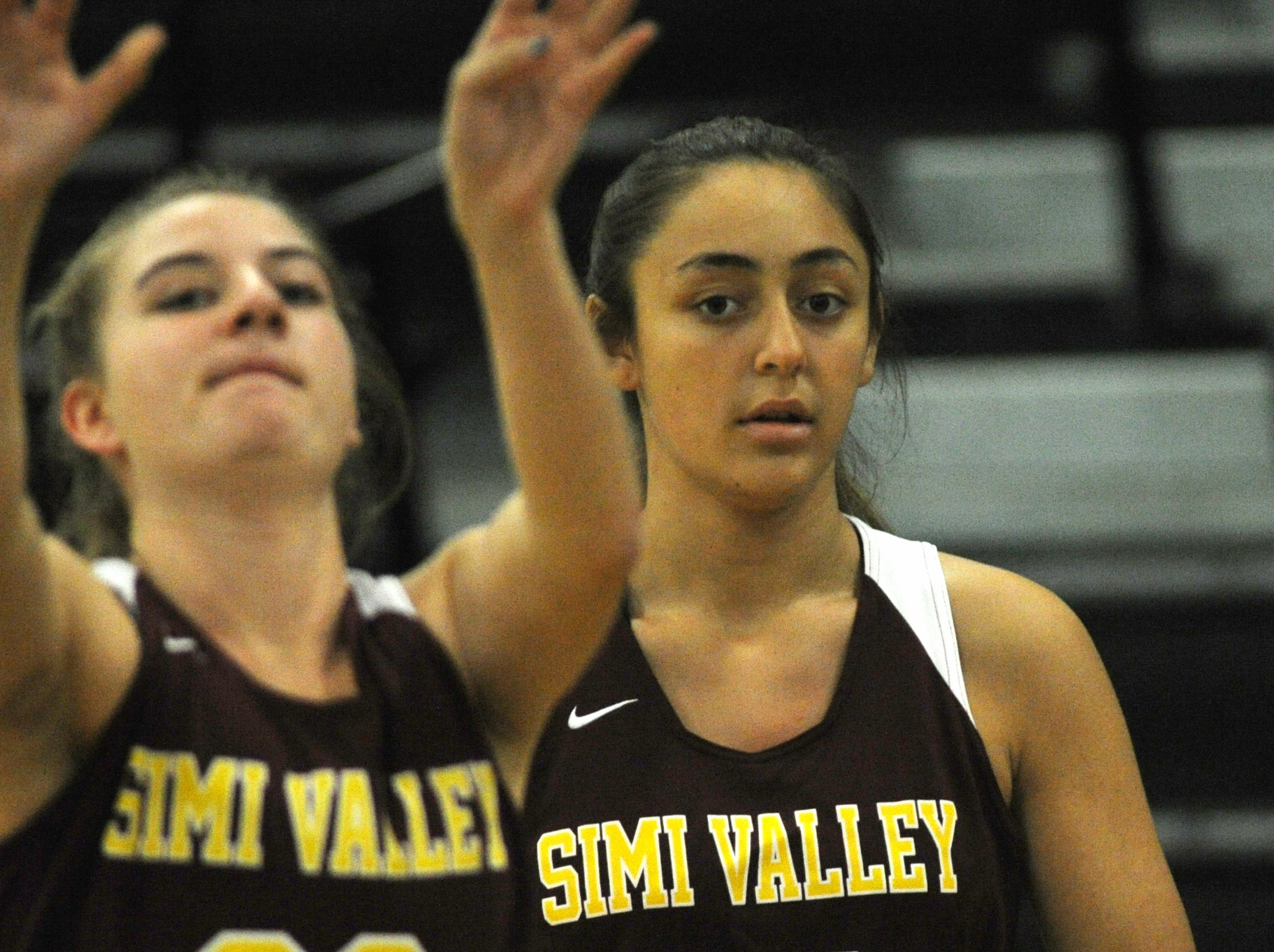 Simi Valley's Madison Carabello, left, and Alicia Porter warm up before Wednesday's game against Buena in the 42nd annual Buena-Kiwanis Girls Basketball Tournament at Buena High. Buena won, 62-34.