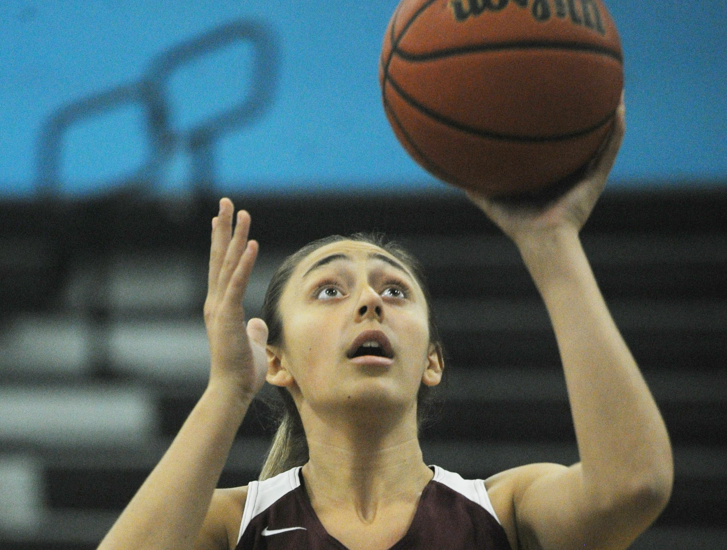Simi Valley's Alicia Porter goes up for a layup against Buena during the second game of the 42nd annual Buena-Kiwanis Girls Basketball Tournament at Buena High on Wednesday. Buena won, 62-34.