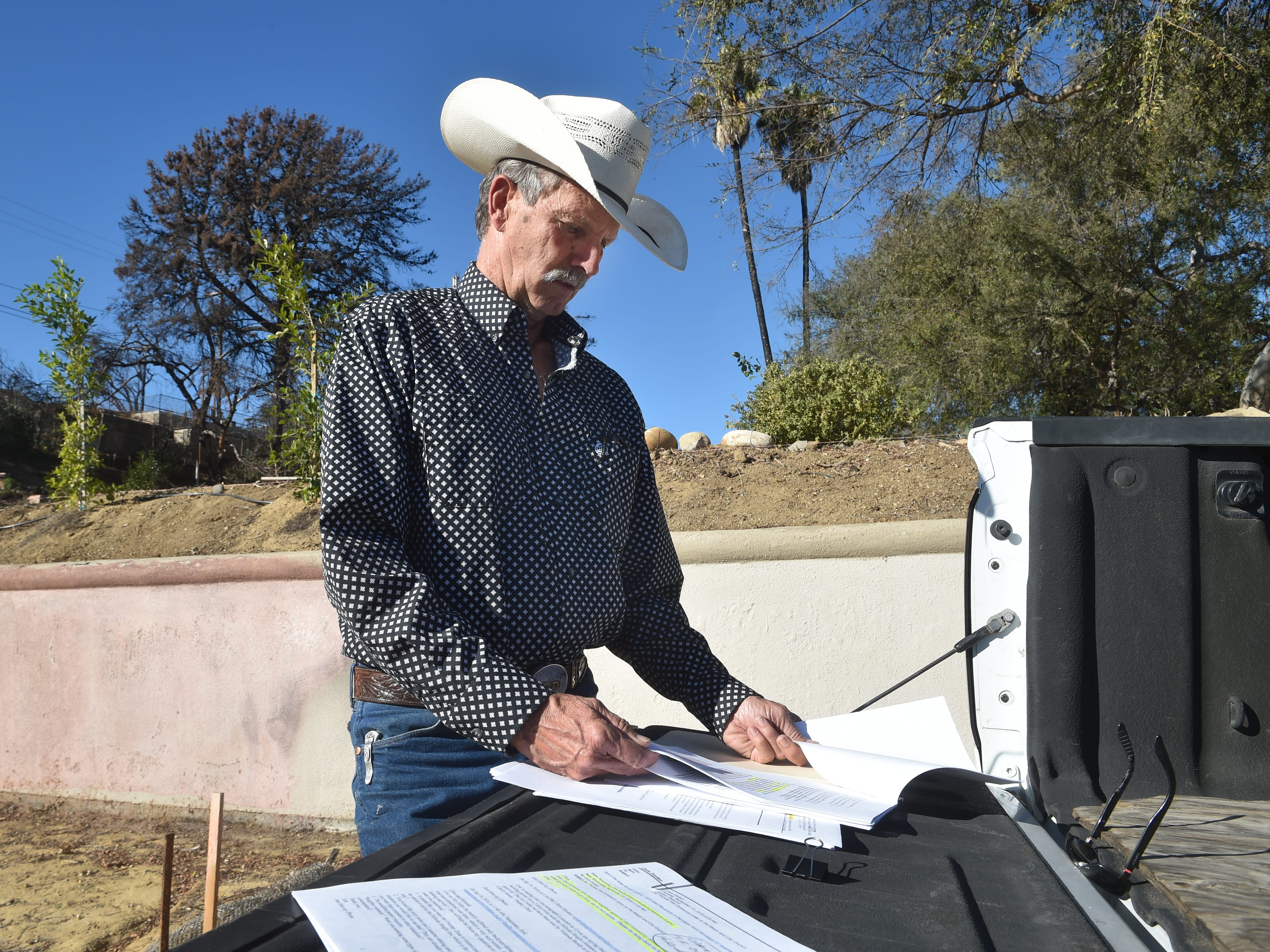 Chris Dryden, of Ventura, visits the lot on Colina Vista where his home burned in the Thomas Fire. While many of his neighbors have chosen sell the lots where their homes once stood, Dryden and his family are determined to rebuild despite obstacles.
