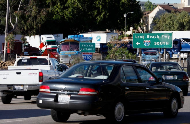 This April 21, 2010, file photo shows an early morning traffic jam at the entrance to southbound Interstate 710 freeway in Alhambra. A proposal to build a 5-mile tunnel linking two Los Angeles-area freeways is dead after state officials decided on a street-improvement plan instead.