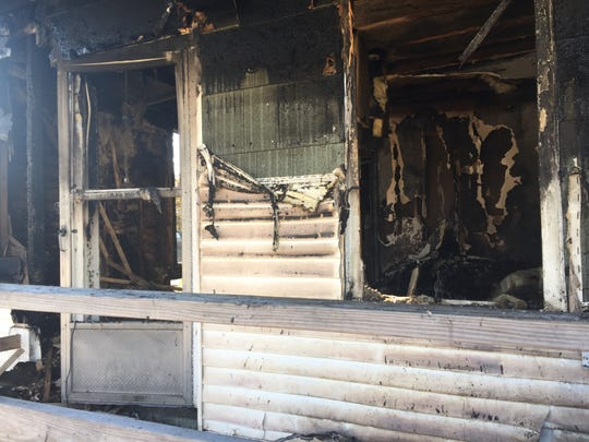 This is a frontal view on Thursday of 700 Buck Street in Millville. The house is posted as unsafe due to damage from the fire and impact of a pickup truck into the foundation.