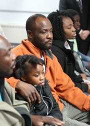 Family members of Youbens Joseph, including his brother, Enix Joseph, daughter, Kaelah, 7, brother Nixon Joseph and wife, Keren Joseph, attend a press conference at Clarkstown Police headquarters in New City Nov. 29, 2018. Joseph was murdered at his auto business in West Nyack on Nov. 24, 2018