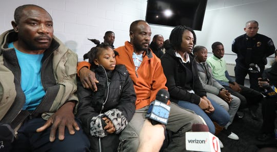Family members of Youbens Joseph, including his brother, Enix Joseph, left, daughter, Kaelah, 7, brother Nixon Joseph and wife, Keren Joseph, attend a press conference at Clarkstown Police headquarters in New City Nov. 29, 2018. Joseph was murdered at his auto business in West Nyack on Nov. 24, 2018
