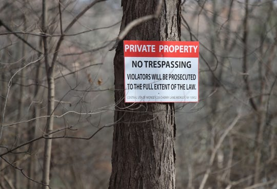 A private property sign on a tree outside the United Talmudical Academy of Monsey on Cherry Lane in the Village of Airmont on Thursday, November 29, 2018.