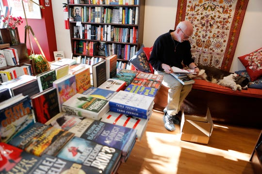 Mark Fowler, co-owner of Bronx River Books in Scarsdale works on shipment at the store on Nov. 29, 2018.