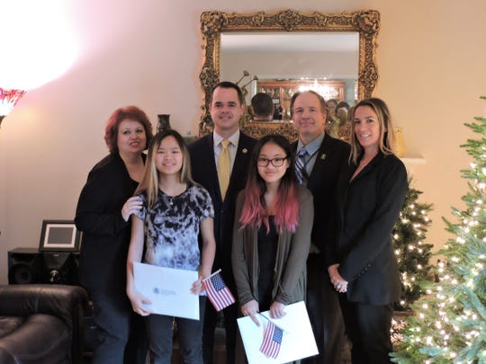 From L: Tara Handsman, Jade Handsman, State Sen. David Carlucci, Skylar Handsman, New York District Director Tom Cioppa and Field Officer Director Barbara Owlett, both of the U.S. Citizenship and Immigration Services. Tara and Skylar were given their citizenship on Nov. 29. Their parents, Tara and Alan Handsman, adopted them when they were little.
