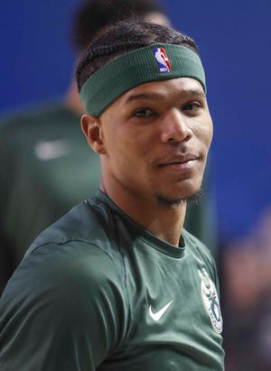 Trevon Duval warms up before playing for the Wisconsin Herd against the Delaware Blue Coats in G-League action at the Bob Carpenter Center Wednesday as he works to make the Milwaukee Bucks squad full-time.