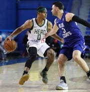 Trevon Duval of the Wisconsin Herd (left) takes on Blue Coats' Matt Farrell in G-League play at the Bob Carpenter Center Wednesday as Duval works to make the Milwaukee Bucks squad full-time.