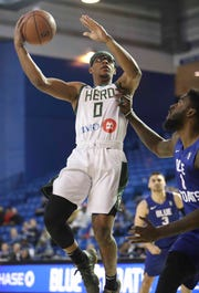 Trevon Duval of the Wisconsin Herd (left) shoots over the Blue Coats' Norvel Pelle G-League play at the Bob Carpenter Center Wednesday as Duval works to make the Milwaukee Bucks squad full-time.