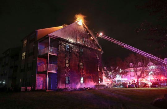 Firefighters battle a blaze that severely damaged several units in the Rockwood Apartments in Bear, reported shortly before 9 p.m. Wednesday.