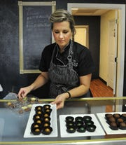 Brooke Willis, owner of B Cocoa Artisan Chocolate shows an order of their sweet treats, Wednesday, in her shop located in the Finishing Touch Plaza located on Rhea Rd.