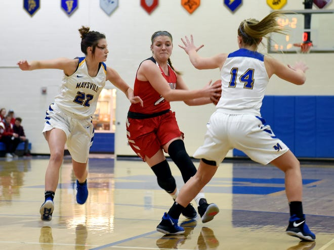 Kendyl Mick drives into the lane against Maysville's Macie Jarrett, left, and Brooke Smith during Sheridan's 75-45 win on Wednesday in Newton Township. Mick scored seven points with team-highs of 11 rebounds and 11 assists.
