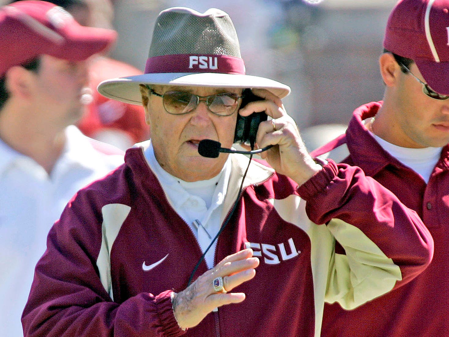 Bobby Bowden talks to his coaches during the second quarter of a game against Virginia, on Nov. 4, 2006.