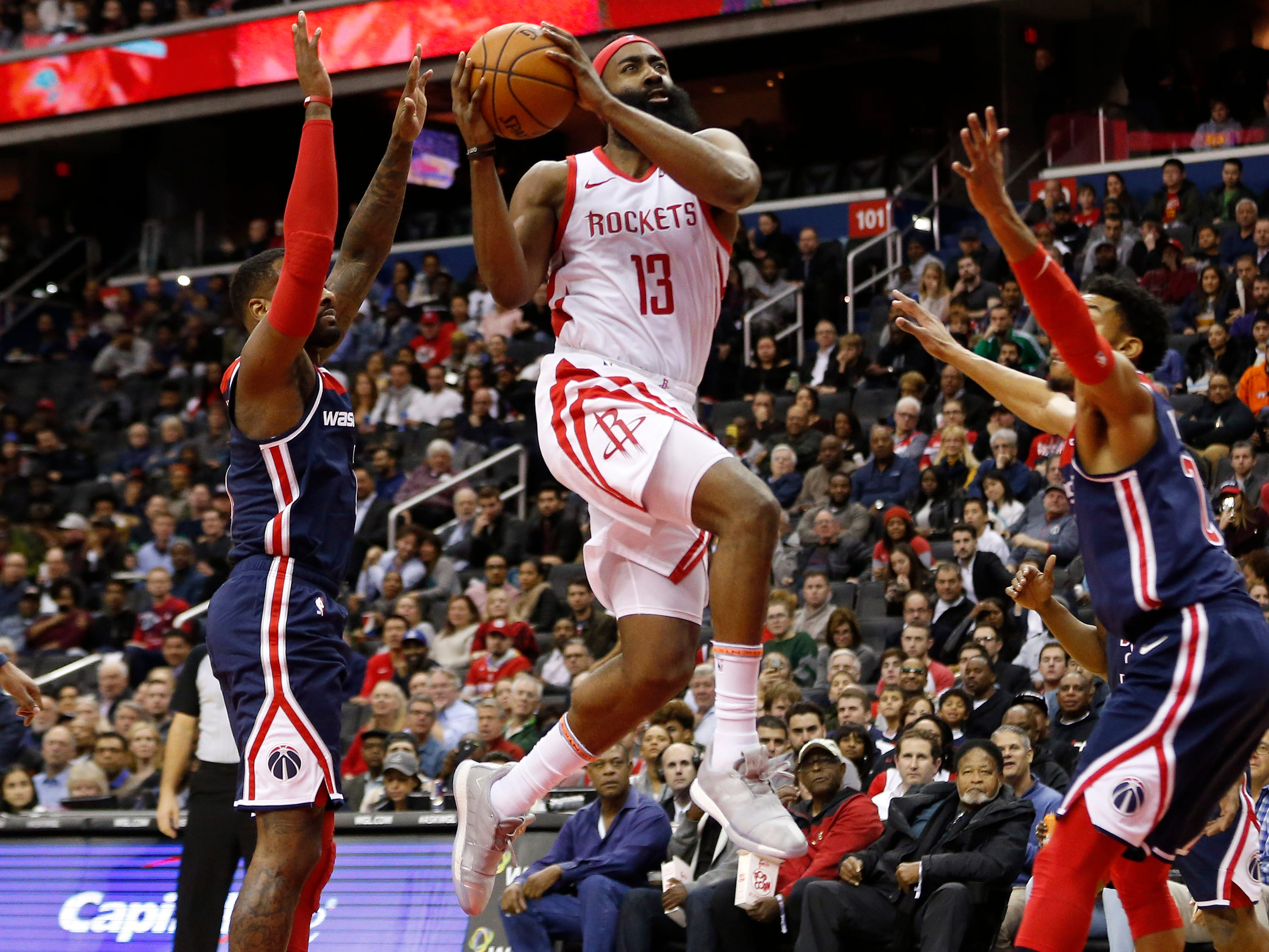 Nov. 26: Rockets guard James Harden (13) drives to the bucket between Wizards defenders John Wall (2) and Otto Porter Jr. (22) for two of his season-high 54 points in Washington.
