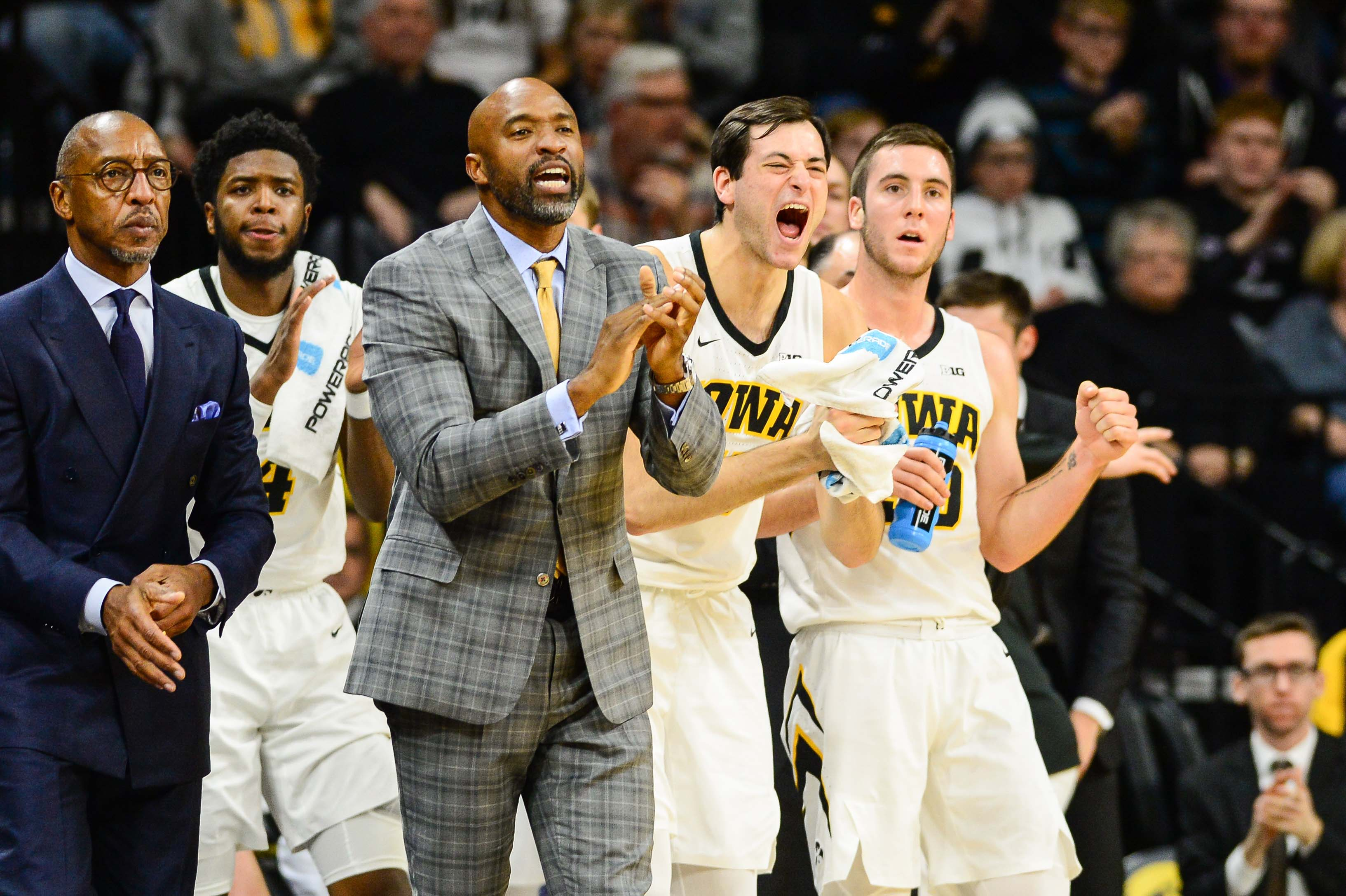 The Iowa bench celebrates during Tuesday's wn over Pitt at Carver-Hawkeye Arena.