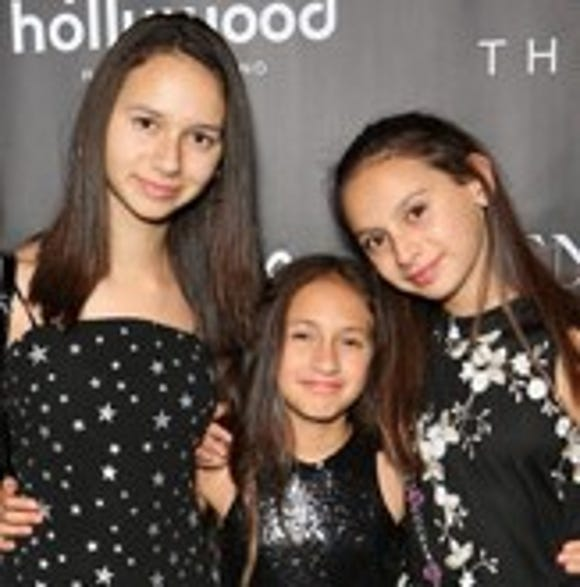 "Alex Rodriguez's daughters Ella Alexander Rodriguez, left, and Natasha Alexander Rodriguez, right, join Jennifer Lopez's daughte,r Emme Maribel Muniz, at the after-party for the finale of the ""Jennifer Lopez: All I Have"" residency in Las Vegas in September."