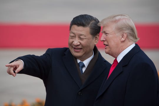 In this file photo taken on November 9, 2017, China's President Xi Jinping (L) and U.S. President Donald Trump attend a welcome ceremony at the Great Hall of the People in Beijing.