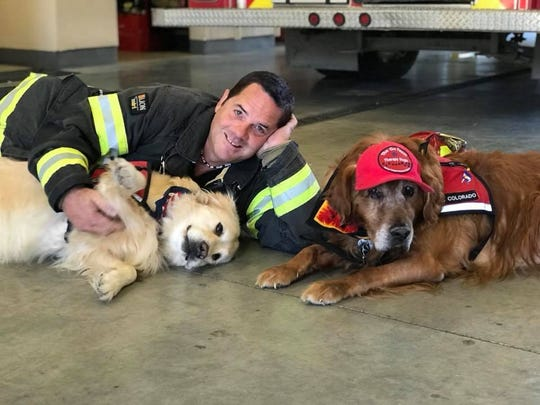 Donald Westcott Fire Detpt. Lt. Shaun Leonhardt with Snickers (left) and Tabor (right).