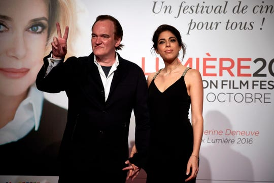 Quentin Tarantino poses with Daniella Pick on Oct. 8, 2016 in Lyon central eastern France.