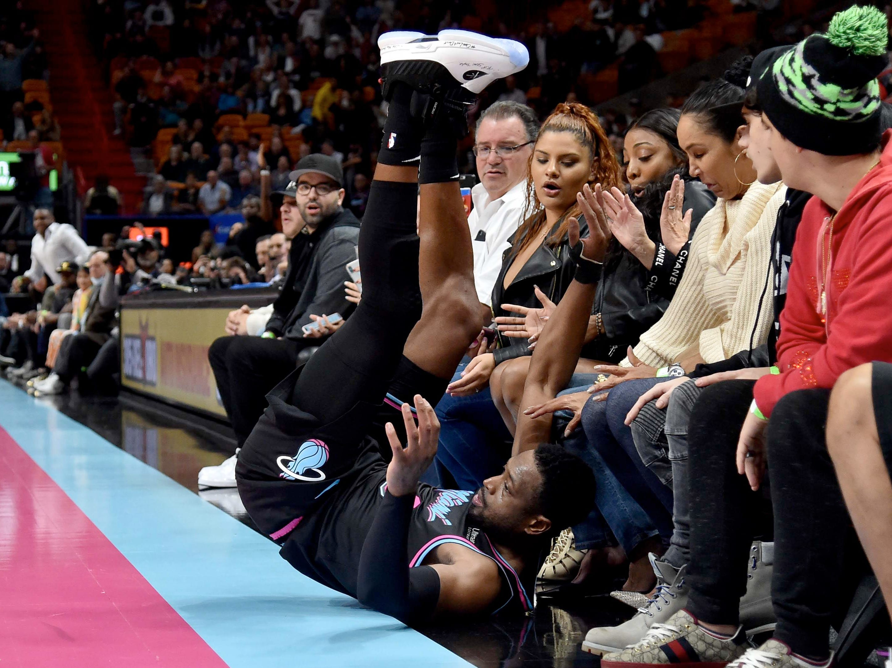 Nov. 27: Heat guard Dwyane Wade tumbles into the first row of fans during the second half against the Hawks in Miami.