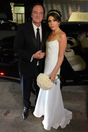 Quentin Tarantino and Daniella Pick were seen arriving at their wedding reception in Los Angeles, CA.