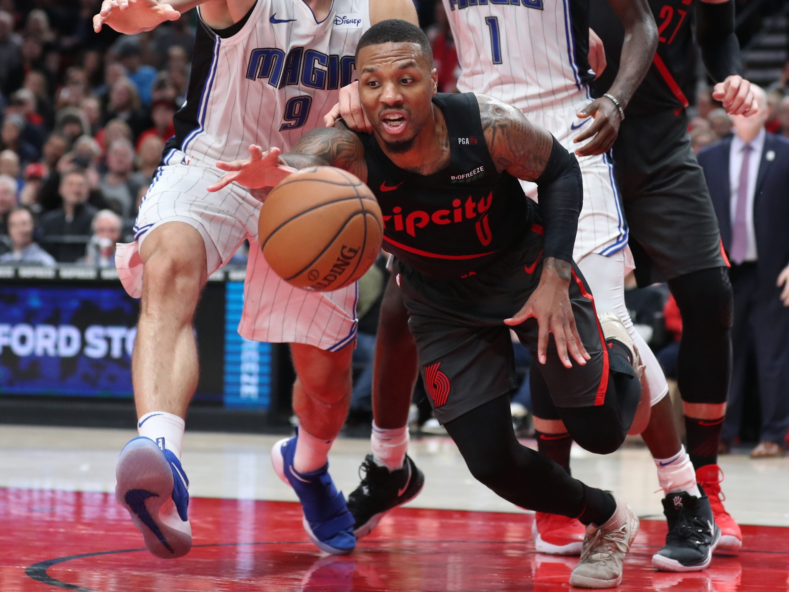 Nov. 28: Trail Blazers guard Damian Lillard dives for a loose ball during the first half against the Magic in Portland.