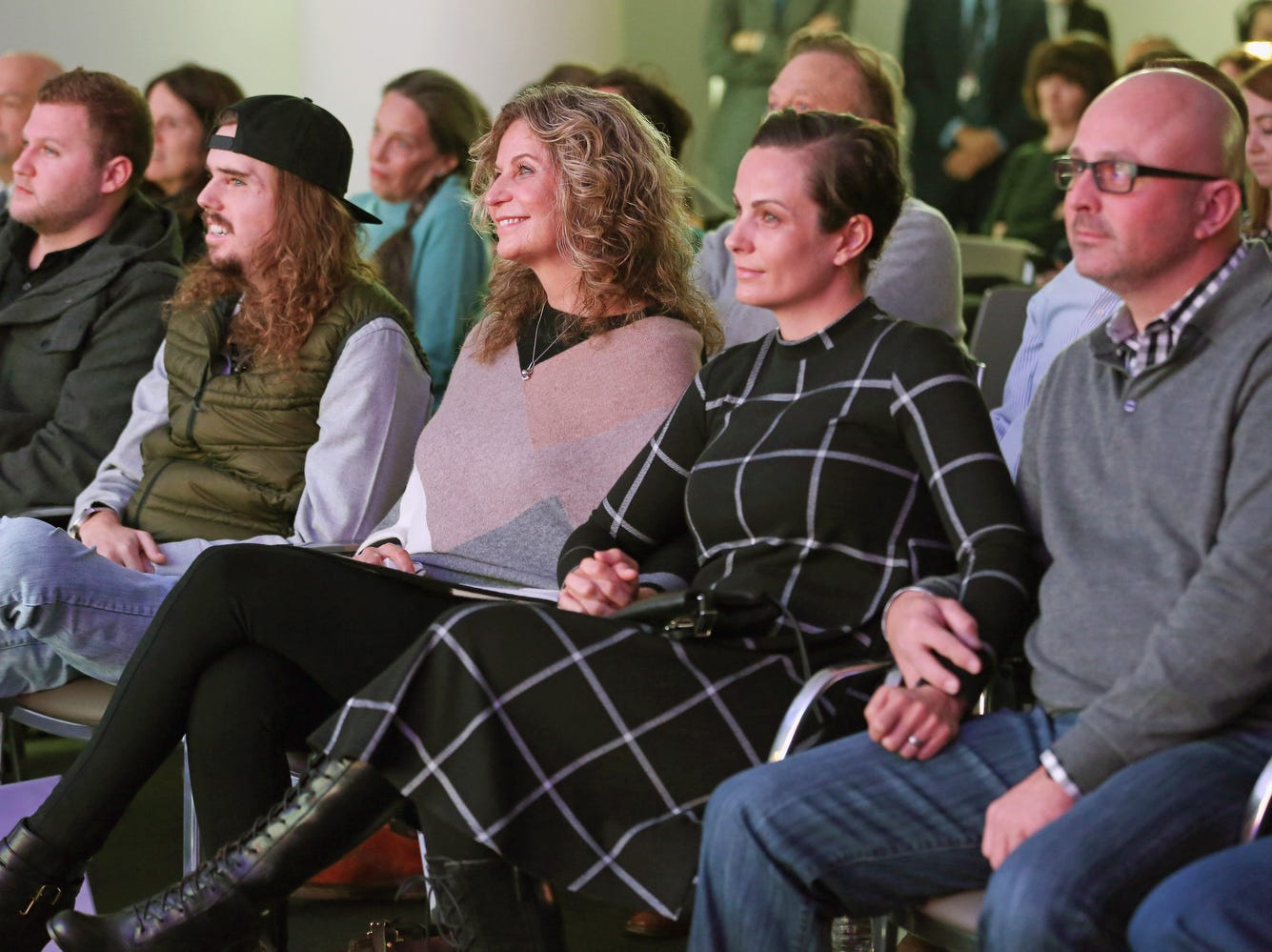Cameron Underwood, 2nd left, his mother Bev Bailey-Potter, and family attend the 2018 NYU Langone Face Transplant Announcement.