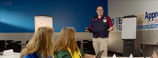 Facilitator Cole Barton teaches employees the importance of having quality standards.