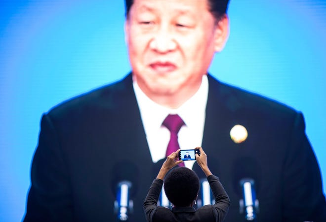 Chinese President Xi Jinping is seen on a big screen as he speaks at an import expo in Shanghai on Nov. 5, 2018.