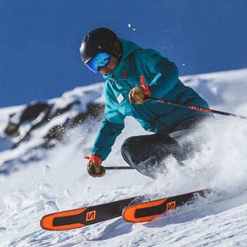An instructor shows how to ski the high alpine terrain near the peak of Whistler.