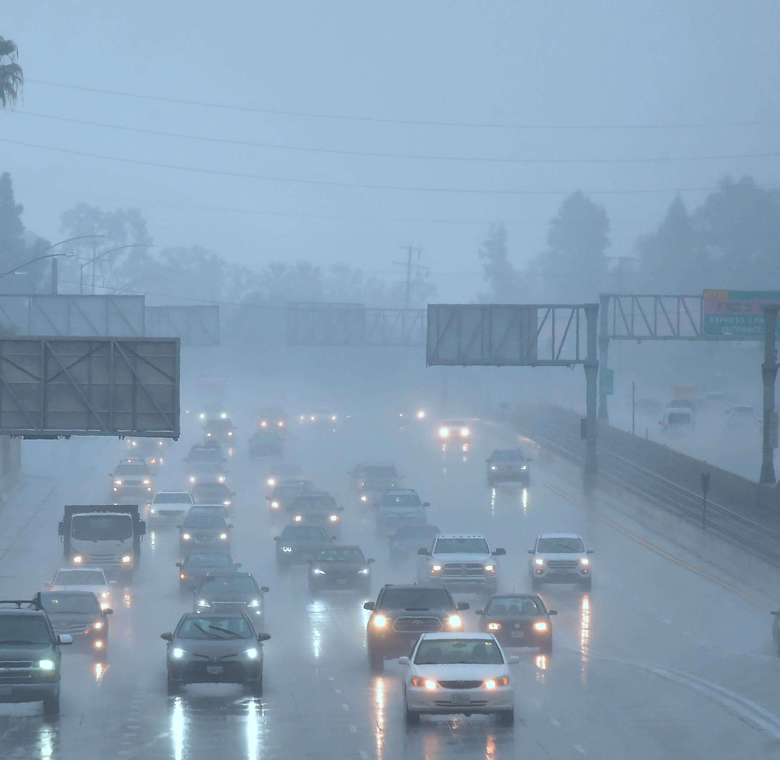 Commuters drive under heavy rainfall in Los Angeles, on March 21, 2018.