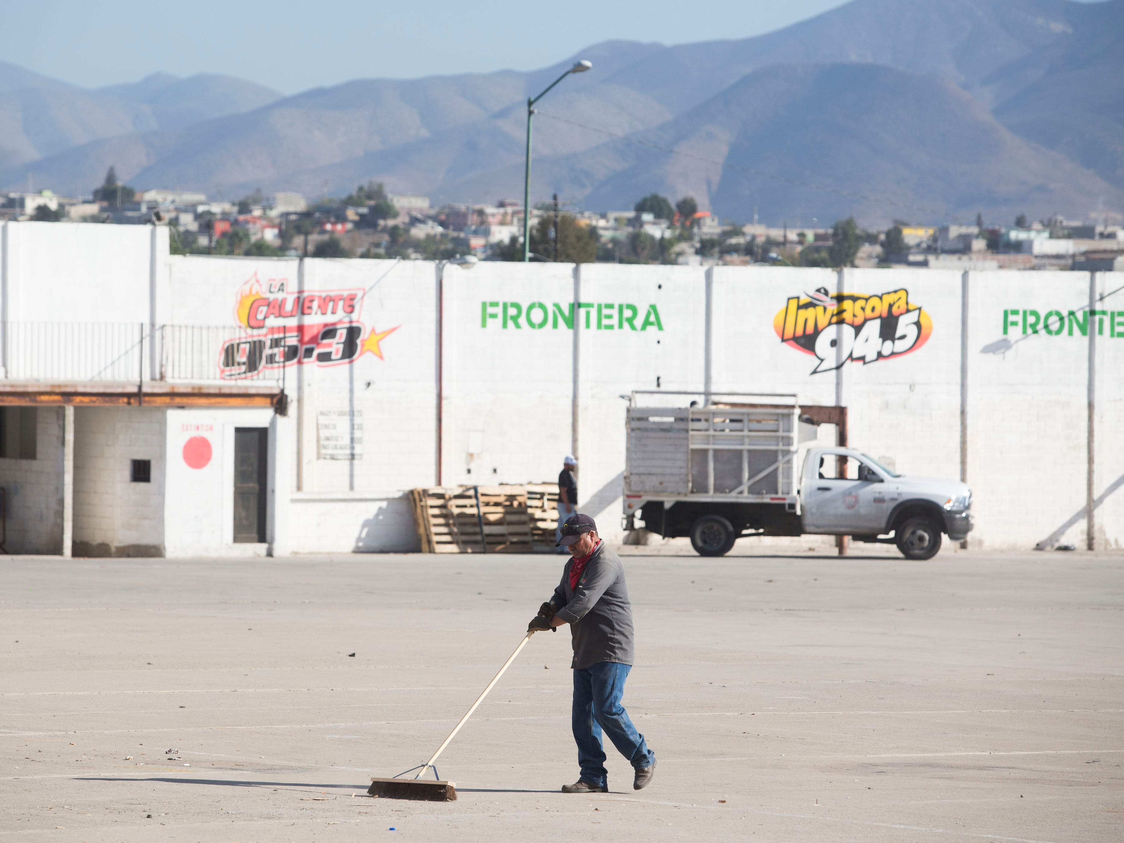 Crews clean up a building where a second shelter may be opened for the caravan migrants on Nov. 28, 2018. If the migrants agree to move to the new shelter, they would be moved 11 kilometers from the San Ysidro Port of Entry to the new shelter.