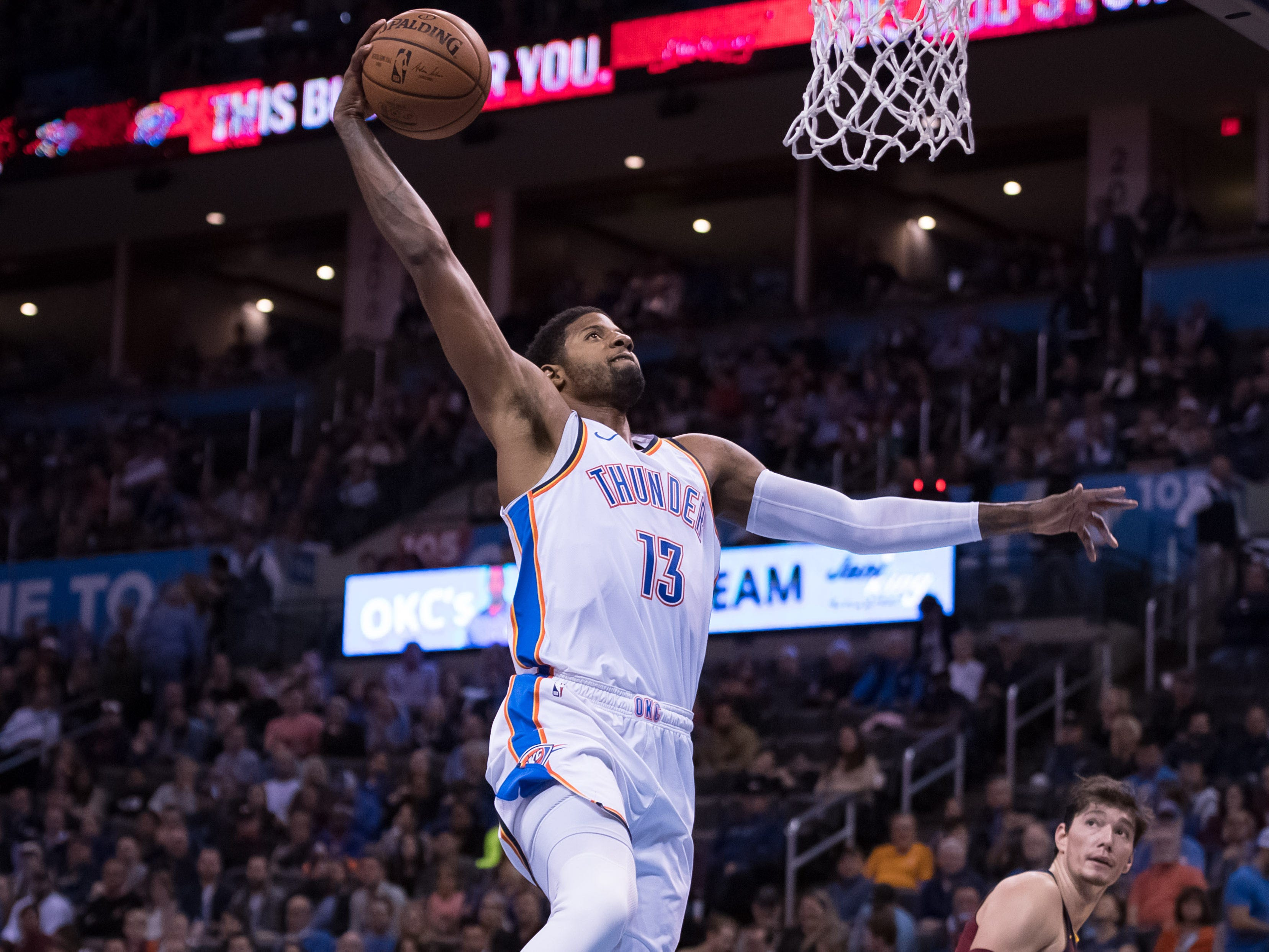 Nov. 28: Thunder forward Paul George rises up for a one-handed slam during the second half against the Cavaliers in Oklahoma City.