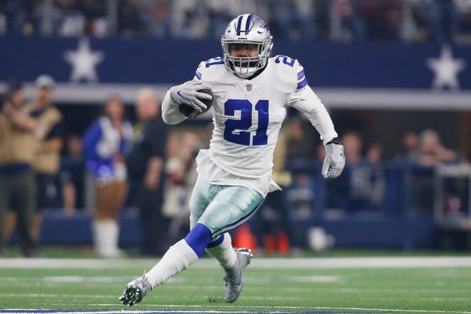 Dallas Cowboys running back Ezekiel Elliott (21) runs the ball in the third quarter against the Washington Redskins at AT&T Stadium.